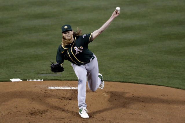 Oakland Athletics starting pitcher A.J. Puk pitches to a Chicago Cubs batter during the first inning of a spring training baseball game Saturday, Feb. 22, 2020, in Mesa, Ariz. (AP Photo/Gregory Bull)