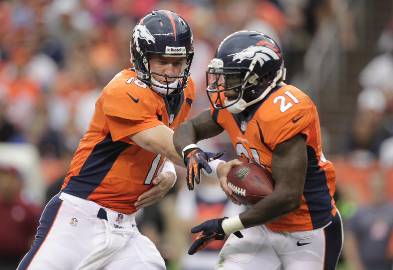 Denver Broncos quarterback Peyton Manning (18) hands the ball off to running back Ronnie Hillman (21) in the second quarter of a preseason NFL football game, Saturday, Aug. 24, 2013, in Denver. (AP Photo/Joe Mahoney)