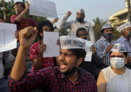 Members of Aam Aadmi Party shout slogans demanding the release of Indian climate activist Disha Ravi, during a protest in Mumbai, India, Monday, Feb. 15, 2021. The 22 years old activist was arrested Saturday for circulating a document on social media that allegedly incited protesting farmers to turn violent last month. (AP Photo/Rafiq Maqbool)