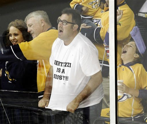Country music star Vince Gill cheers along with other Nashville Predators fans after the Predators scored a goal against the Detroit Red Wings in the third period of Game 2 of an NHL hockey Stanley Cup first-round playoff series, Friday, April 13, 2012, in Nashville, Tenn. Todd Bertuzzi is a forward for the Red Wings. The Red Wings won 3-2. (AP Photo/Mark Humphrey)