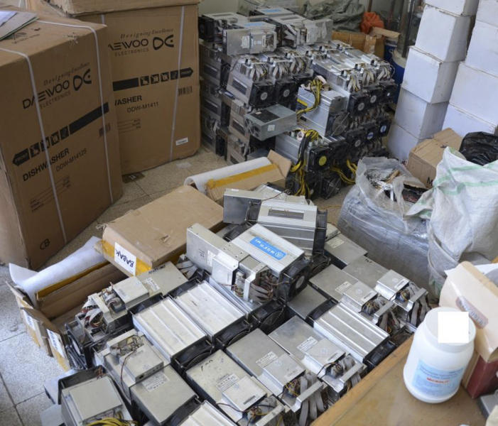 "This undated photo provided by the Police News Agency, shows boxes of machinery used in Bitcoin ""mining"" operations that were confiscated by police in Nazarabad, Iran. Squeezed by sanctions and fueled by subsidized electricity, Iranians and others lured to the country increasingly are turning to Bitcoin and other digital cryptocurrencies. Some mine for the currency. That involves harnessing the power of their computers to verify and secure other users' transactions around the world so that the same bitcoin isn't spent twice. They are given new bitcoins as rewards. (News.police.ir via AP)"