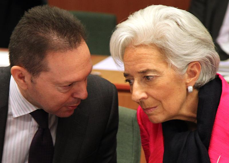 """International Monetary Fund managing director Christine Lagarde, right, talks with Greek Finance Minister Yannis Stournaras, during the Eurogroup finance ministers meeting in Brussels, Monday, Nov, 12, 2012. Greece's international lenders have prepared a """"positive"""" report on the country's reform efforts, a crucial step in its efforts to secure the next installment of its bailout loan, the head the of group of finance ministers from the 17 euro countries said Monday. (AP Photo/Yves Logghe)"""
