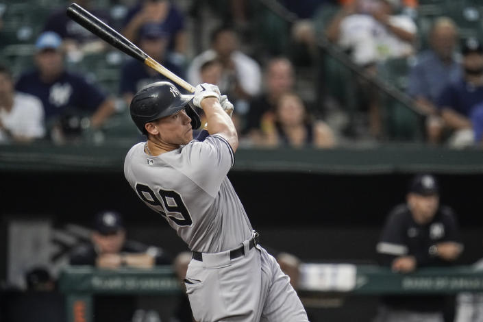 New York Yankees' Aaron Judge connects for a two-run home run off Baltimore Orioles starting pitcher Alexander Wells during the first inning of a baseball game, Tuesday, Sept. 14, 2021, in Baltimore. (AP Photo/Julio Cortez)
