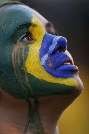 A fan of Brazil reacts while watching a broadcast of the 2014 World Cup semi-final against Germany at the Fan Fest in Brasilia, July 8, 2014. REUTERS/Ueslei Marcelino