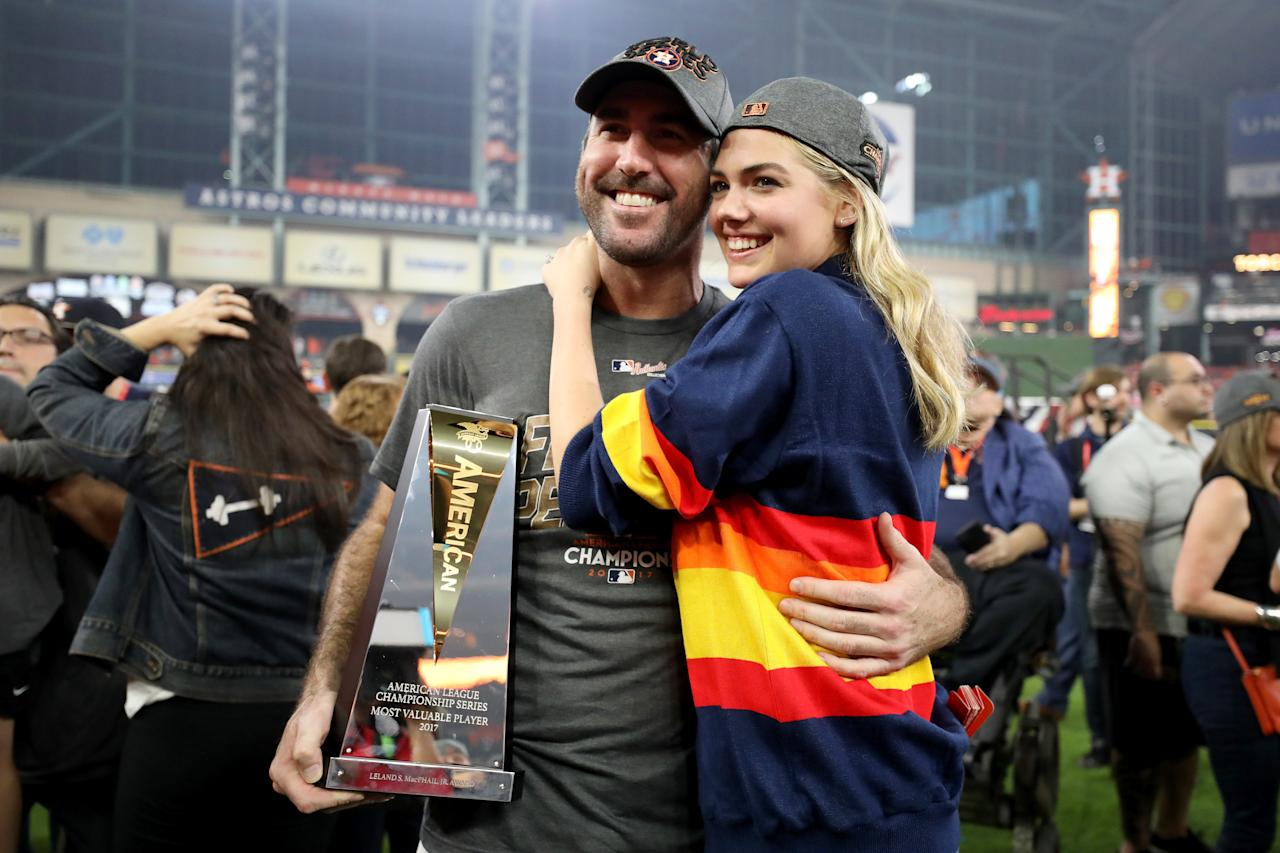 <p>Justin Verlander #35 of the Houston Astros celebrates with model Kate Upton and the MVP trophy after defeating the New York Yankees by a score of 4-0 to win Game Seven of the American League Championship Series at Minute Maid Park on October 21, 2017 in Houston, Texas. The Houston Astros advance to face the Los Angeles Dodgers in the World Series. (Photo by Ronald Martinez/Getty Images) </p>