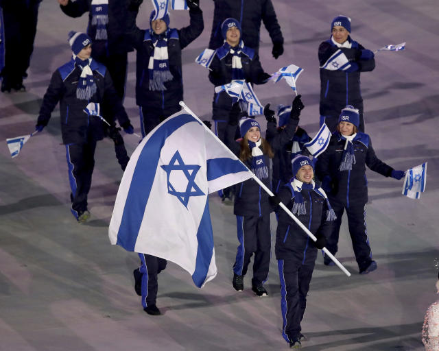 <p>Alexei Bychenko carries the flag of Israel during the opening ceremony of the 2018 Winter Olympics in Pyeongchang, South Korea, Friday, Feb. 9, 2018. (Sean Haffey/Pool Photo via AP) </p>