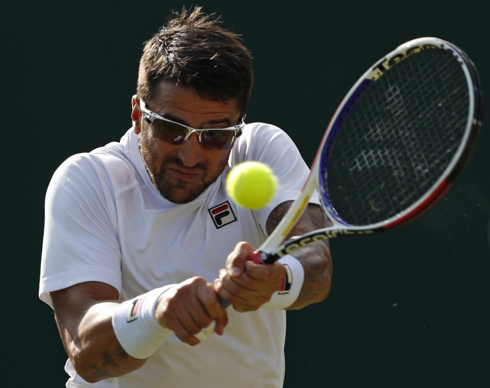 Serbia's Janko Tipsarevic returns against South Africa's Kevin Anderson during their men's singles second round match on the third day of the 2019 Wimbledon Championships at The All England Lawn Tennis Club in Wimbledon, southwest London, on July 3, 2019. (Photo by Adrian Dennis/AFP/Getty Images)