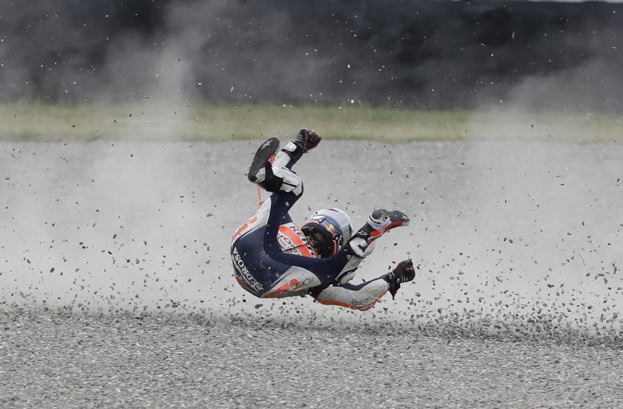 <p>Spain's Dani Pedroza rolls on the gravel after he fell off his Honda during Argentina's Motorcycle Grand Prix at the Termas de Rio Hondo circuit in Argentina, April 9, 2017. (Photo: Natacha Pisarenko/AP) </p>