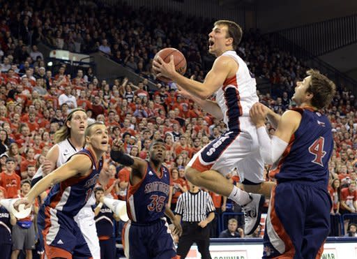 Saint Mary's defense, from left, Beau Levesque, James Walker III (35) and Matthew Dellavedova (4) tries to stop Gonzaga's Kevin Pangos, as Gonzaga's Kelly Olynyk watches in the first half of an NCAA college basketball game, Thursday, Jan. 10, 2013, in Spokane, Wash. (AP Photo/Jed Conklin)