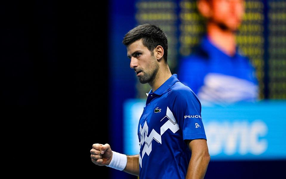 Novak Djokovic of Serbia celebrates his victory over Alexander Zverev of Germany on Day 6 of the Nitto ATP World Tour Finals at The O2 Arena on November 20, 2020 in London, England. - GETTY IMAGES