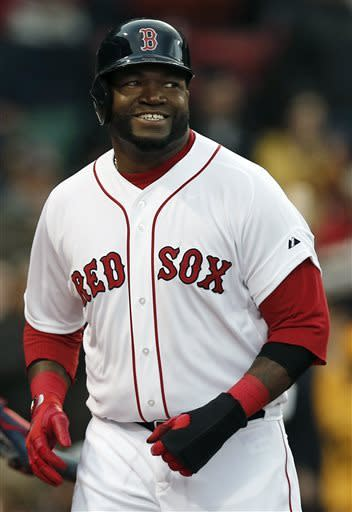 Boston Red Sox's David Ortiz smiles after scoring on a double by teammate Mike Napoli during the second inning of a baseball game against the Oakland Athletics at Fenway Park in Boston on Monday, April 22, 2013. (AP Photo/Winslow Townson)