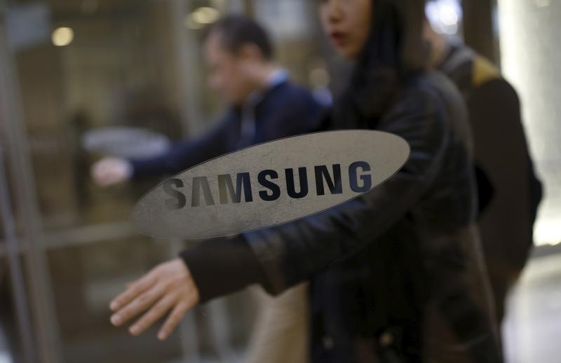 Employees walk in the main office building of Samsung Electronics in Seoul