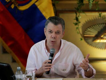 Colombia's President Santos addresses the audience during a meeting with his Ecuadorean counterpart Correa as formal peace talks with the ELN go underway, in Guayaquil