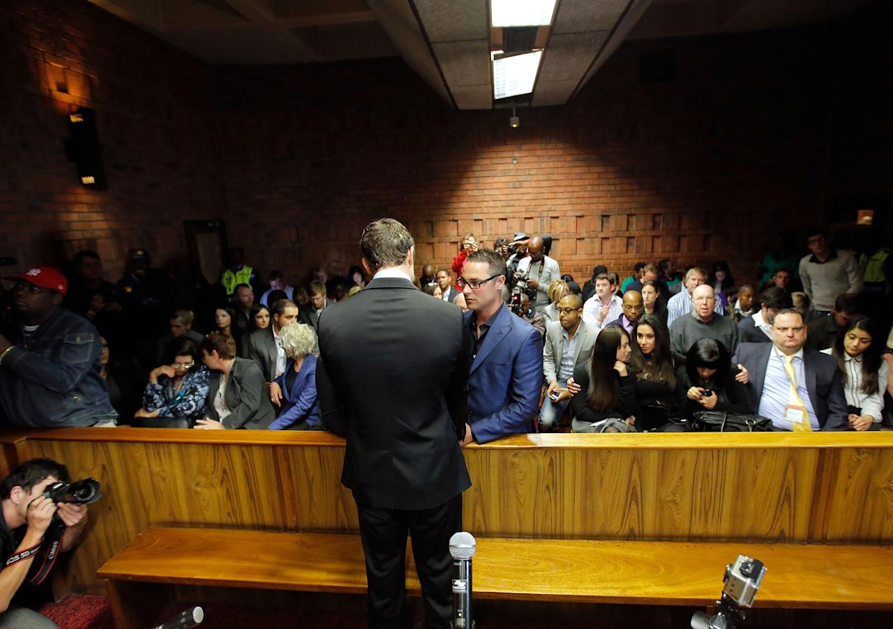 PRETORIA, SOUTH AFRICA - AUGUST 19: South African athlete Oscar Pistorius and his brother Carl Pistorius appear in Pretoria Magistrates Court for an indictment hearing on August 19, 2013 in Pretoria, South Africa. Oscar Pistorius, 26, is accused of murdering his girlfriend Reeva Steenkamp which Pistorius denies claiming he mistook Steenkamp for an intruder. The indictment was served and the trial date of March 3, 2014 has now been set. (Photo by Jemal Countess/Getty Images)