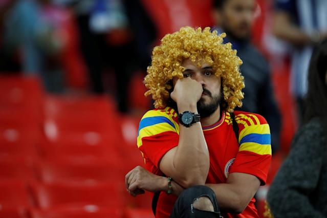 <p>Colombia fan looks dejected after losing the penalty shootout. REUTERS/Carl Recine </p>