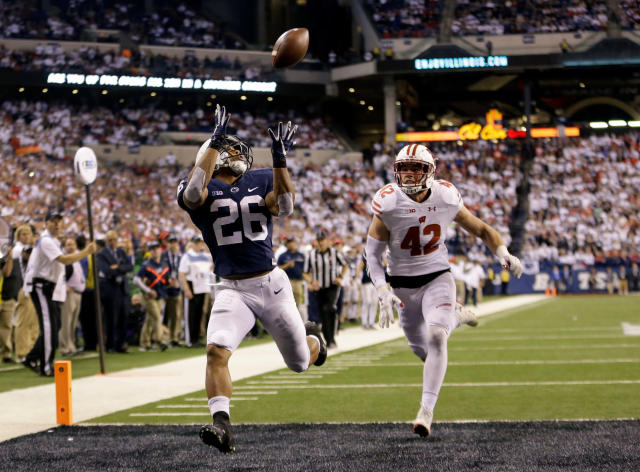 FILE - In this Dec. 3, 2016, file photo, Penn State's Saquon Barkley (26) makes an 18-yard touchdown catch against Wisconsin's T.J. Watt (42) during the second half of the Big Ten championship NCAA college football game, in Indianapolis. Despite the screams from Big Blue fans to find the replacement for Eli Manning, the Giants believe he has two or three very good years left. Helping Manning recapture the glory will be the highest-rated player in the entire draft. (AP Photo/AJ Mast, File)
