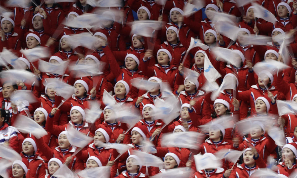 FILE - In this Feb. 22, 2018, file photo, North Korean cheerleaders sing during the men's 500 meters short track speedskating semifinal in the Gangneung Ice Arena at the 2018 Winter Olympics in Gangneung, South Korea. At the Winter Games in Pyeongchang, North Korea had no real medal contenders, but it was among the most watched nations at the Games, with a huge delegation highlighted by a 229-member strong, all-female cheering squad. (AP Photo/David J. Phillip, File)
