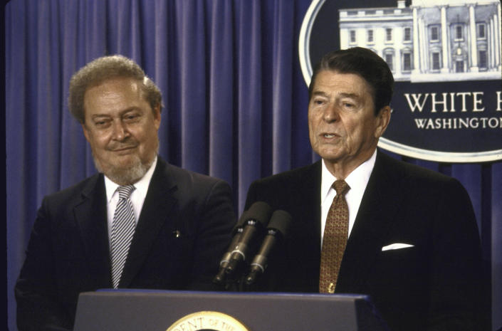 US President Ronald W. Reagan speaking at a press conference while standing with his Supreme Court Justice nominee Robert H. Bork. (Photo by Diana Walker//The LIFE Images Collection via Getty Images)