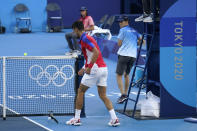 Novak Djokovic, of Serbia, breaks his racket during the bronze medal match of the tennis competition against Pablo Carreno Busta, of Spain, at the 2020 Summer Olympics, Saturday, July 31, 2021, in Tokyo, Japan. (AP Photo/Seth Wenig)