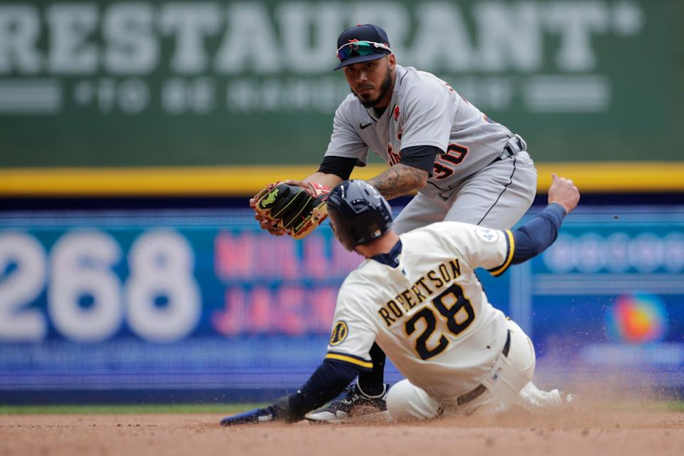 Detroit Tigers' Harold Castro forces out Milwaukee Brewers' Daniel Robertson (28) at second base during the sixth inning of a baseball game Monday, May 31, 2021, in Milwaukee.