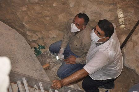 Mostafa Wazir (L), Secretary General of the Supreme Council of Antiquities, inspects the site of the newly discovered giant black sarcophagus in Sidi Gaber district of Alexandria, Egypt July 19, 2018 in this handout picture courtesy of the Ministry of Antiquities. The Ministry of Antiquities/Handout via Reuters