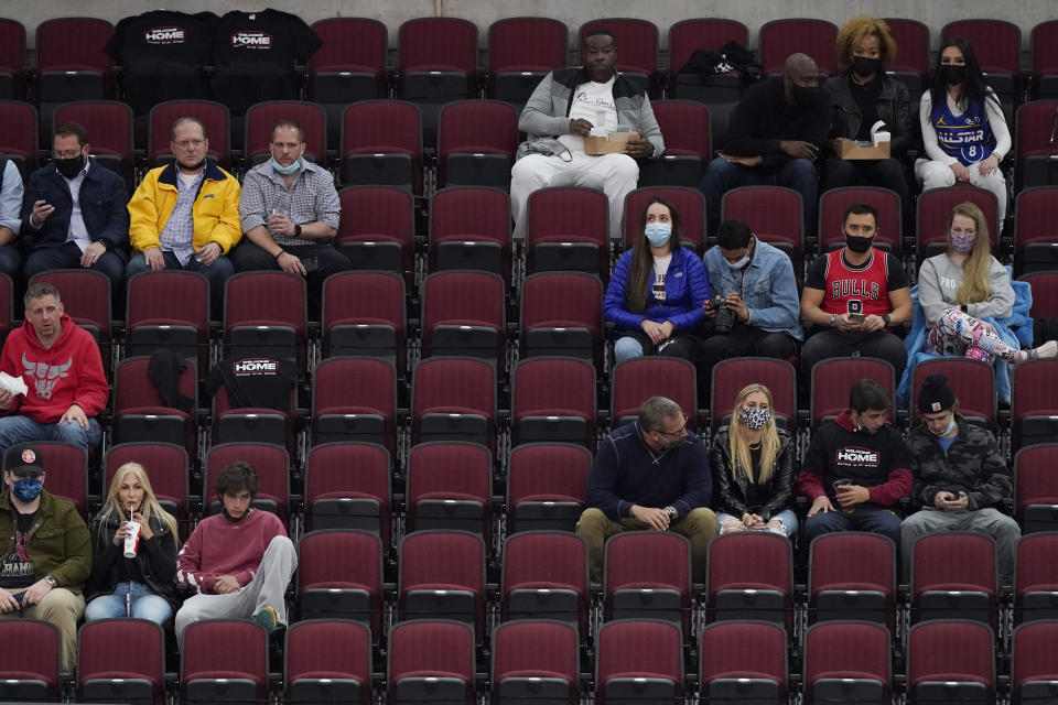 Fans watch an NBA basketball game between the Boston Celtics and the Chicago Bulls in Chicago, Friday, May 7, 2021. (AP Photo/Nam Y. Huh)