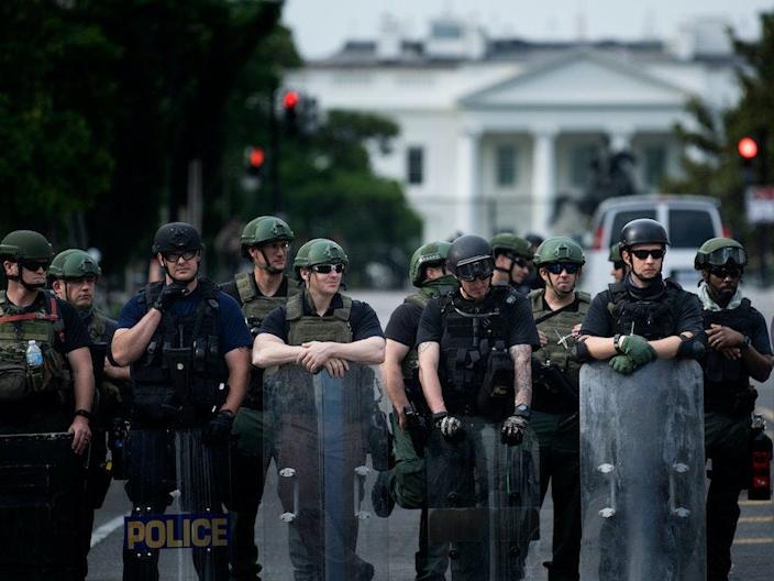 Federal Bureau of Prisons and other law enforcement block 16th Street, NW near the White House on June 3, 2020.