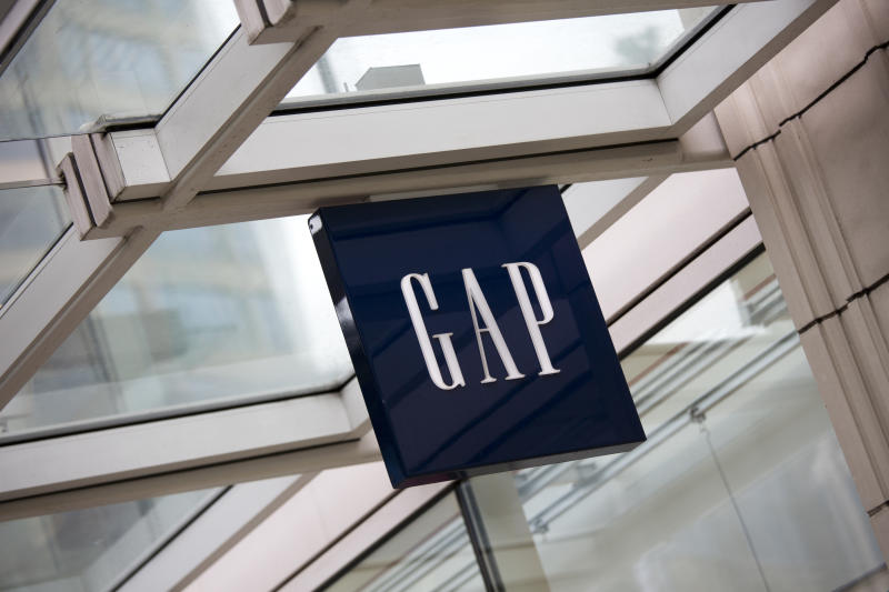 """""""Seattle, Washington, USA - May 27, 2012: The logo and word mark of Gap, mounted above the entrance to the store in downtown Seattle."""""""