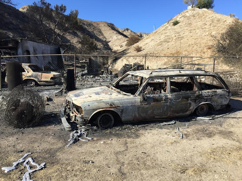 A home and vehicles destroyed by the Tick Fire