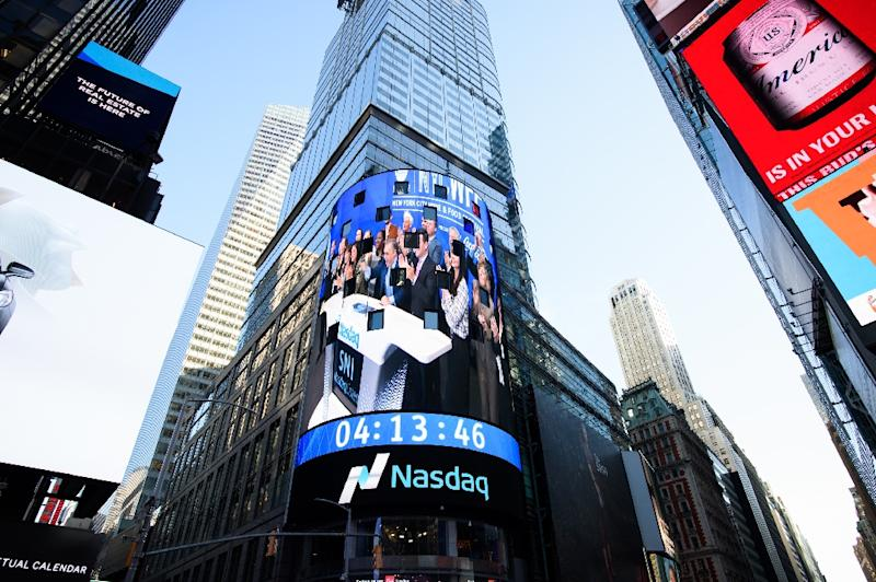 In the US, the Nasdaq fared especially well, with blowout results from Netflix lifting the on-demand television service by nearly 20 percent and positive reviews of Google's new smartphone boosting Google parent Alphabet to a new all-time high (AFP Photo/Dave Kotinsky)