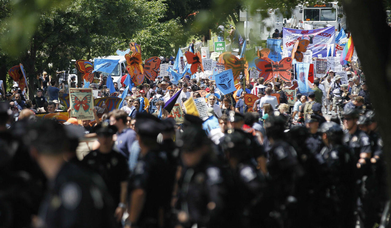 Demonstrators move toward downtown during a protest march, Sunday, Sept. 2, 2012, in Charlotte, N.C. Demonstrators are protesting before the start of the Democratic National Convention. (AP Photo/Gerry Broome)