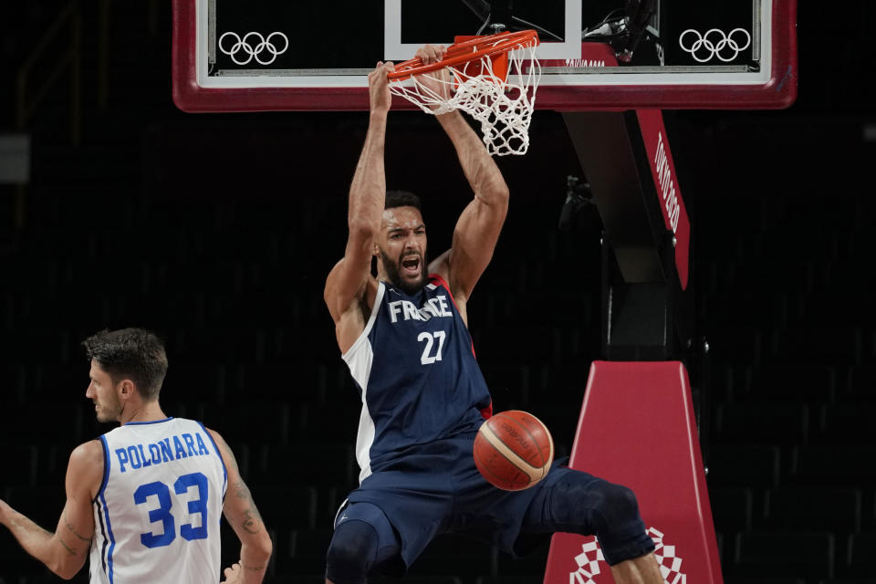 France's Rudy Gobert (27) scores over Italy's Achille Polonara (33) during a men's basketball quarterfinal round game at the 2020 Summer Olympics, Tuesday, Aug. 3, 2021, in Saitama, Japan. (AP Photo/Eric Gay)
