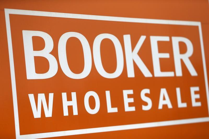 FILE PHOTO: A branded sign is displayed outside of a Booker Wholesale store in London
