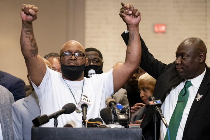 Terrence Floyd, brother of George Floyd, left, raises his hands during a news conference alongside attorney Ben Crump after former Minneapolis police Officer Derek Chauvin is convicted in the killing of George Floyd, Tuesday, April 20, 2021, in Minneapolis. (AP Photo/John Minchillo)