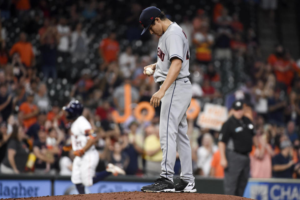Cleveland Indians starting pitcher Eli Morgan, right, looks down as Houston Astros' Jose Altuve, left, runs the bases after hitting a solo home run during the fourth inning of a baseball game Wednesday, July 21, 2021, in Houston. (AP Photo/Eric Christian Smith)