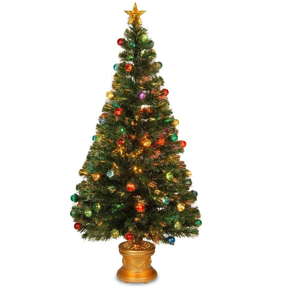 """<p><strong>National Tree Company</strong></p><p>homedepot.com</p><p><strong>$124.31</strong></p><p><a href=""""https://go.redirectingat.com?id=74968X1596630&url=https%3A%2F%2Fwww.homedepot.com%2Fp%2FNational-Tree-Company-5-ft-Fiber-Optic-Fireworks-Artificial-Christmas-Tree-with-Ball-Ornaments-SZOX7-100L-60%2F300496226&sref=https%3A%2F%2Fwww.bestproducts.com%2Fhome%2Fdecor%2Fg334%2Fbest-artificial-christmas-trees%2F"""" rel=""""nofollow noopener"""" target=""""_blank"""" data-ylk=""""slk:Shop Now"""" class=""""link rapid-noclick-resp"""">Shop Now</a></p><p>Have yourself the most colorful Christmas ever by getting this 5-foot-tall Christmas tree that's already decorated for you, complete with ball ornaments, a golden column base, and a star on top.</p><p>The tree's fiber-optic tips showcase a mesmerizing rainbow glow. Many users have noted that while this tree is simple to set up and looks fantastic when illuminated, it is a bit on the smaller side.</p>"""