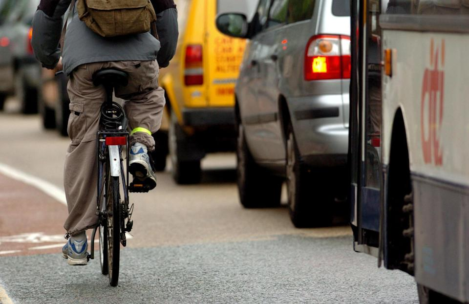 Spain is reportedly forging ahead with measures to keep cyclists safer (file picture of cyclist passing cars in the UK) (PA)