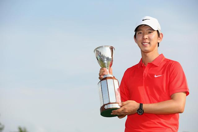 AVONDALE, LA - APRIL 27: Seung-Yul Noh celebrates after his win with the Zurich trophy during the Final Round of the Zurich Classic of New Orleans at TPC Louisiana on April 26, 2014 in Avondale, Louisiana. (Photo by Chris Graythen/Getty Images)