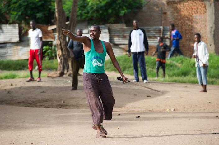 A protestor gestures towards police and Imbonerakure, the youth wing of the ruling CNDD-FDD party, during clashes in the Cibitoke neighbourhood of Bujumbura, on May 7, 2015 (AFP Photo/Phil Moore)