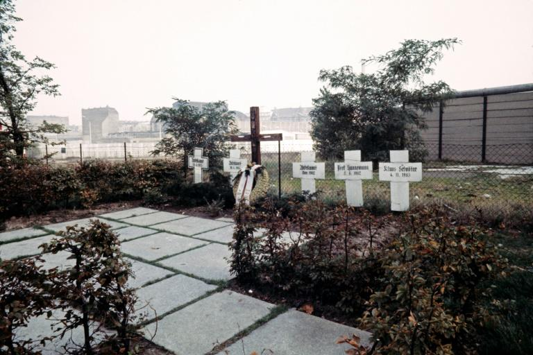 Crosses near the Berlin Wall, pictured in 1976, in tribute to East Berliners who died trying to escape to the West