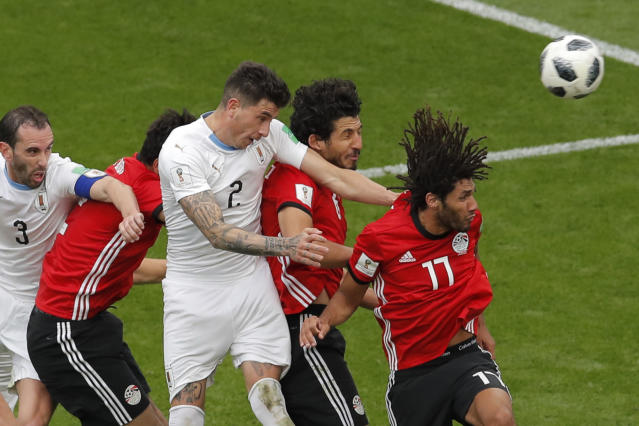 Uruguay's Jose Gimenez, center, heads the ball to score the opening goal during the group A match between Egypt and Uruguay at the 2018 soccer World Cup in the Yekaterinburg Arena in Yekaterinburg, Russia, Friday, June 15, 2018. (AP Photo/Vadim Ghirda)