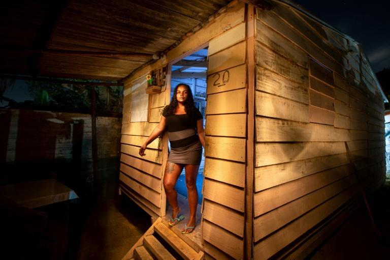 Jaira Andrade do Nascimento poses for a picture outside her home at Manuel Faustino squatter camp, near Salvador, Brazil