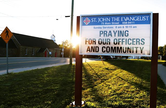 <p>A message at the St. John the Evangelist Anglican Church notifies the community of a prayer vigil after a shooting incident in Fredericton on Aug. 10, 2018. (Photo from Reuters/Dan Culberson) </p>
