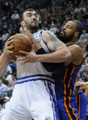 New York Knicks' Tyson Chandler, right, breaks up a scoring attempt by Minnesota Timberwolves' Nikola Pekovic, of Montenegro, in the first half of an NBA basketball game on Saturday, Feb. 11, 2012, in Minneapolis. (AP Photo/Jim Mone)