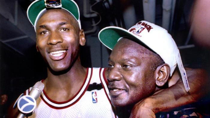 Michael Jordan wraps his arm around his father after winning the 1992 NBA championship. (Reuters)