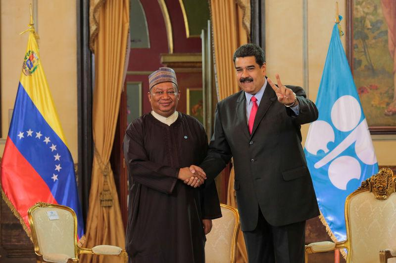 Venezuela's President Nicolas Maduro and OPEC Secretary General Mohammed Barkindo shake hands during their meeting at Miraflores Palace in Caracas