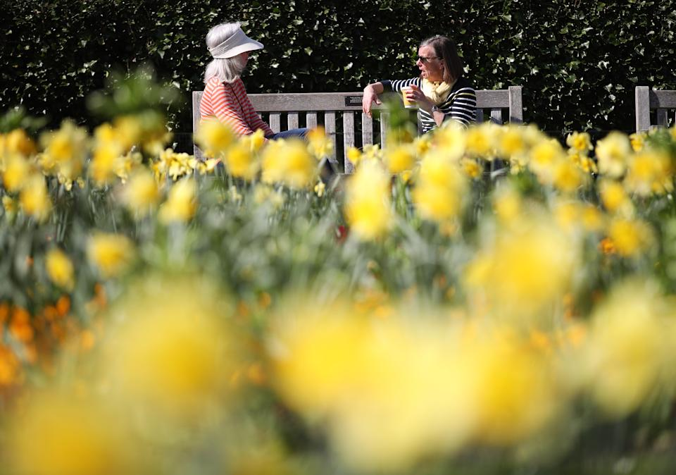 Visitors enjoying the sun at Kew Gardens in south-west London. Picture date: Tuesday March 30, 2021. Temperatures in parts of the UK are expected to be significantly warmer this week as families and friends are reunited and sporting activities are allowed to resume in England.