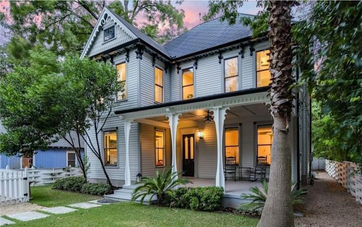 Built in 1890, the three-story home boasts original details such as hand-carved trim, longleaf pine floors and an antique doorbell.