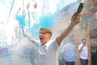 A Tottenham supporter lets of a flare in the streets of Madrid. (Photo by Aaron Chown/PA Images via Getty Images)