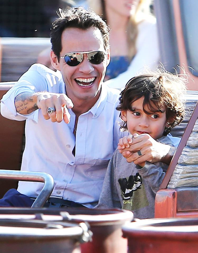 Marc Anthony having a fun day at Disneyland's California Adventure park in Anaheim with his twins and his new girlfriend, Topshop heiress, Chloe Green. The Latin singer rode Mater's Junkyard Jamboree and Toy Story with his son Max, and front seat in the Radiator Springs Racers car, while his girlfriend Chloe Green looked after Emme in the back seat.